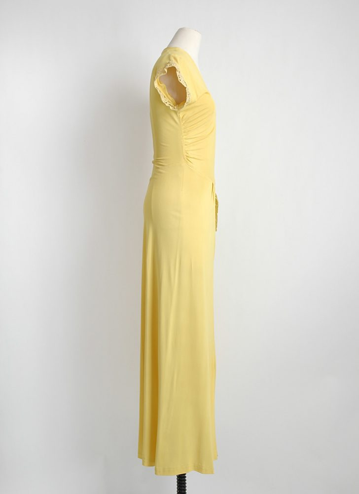 1940s yellow nylon jersey gown with side swag