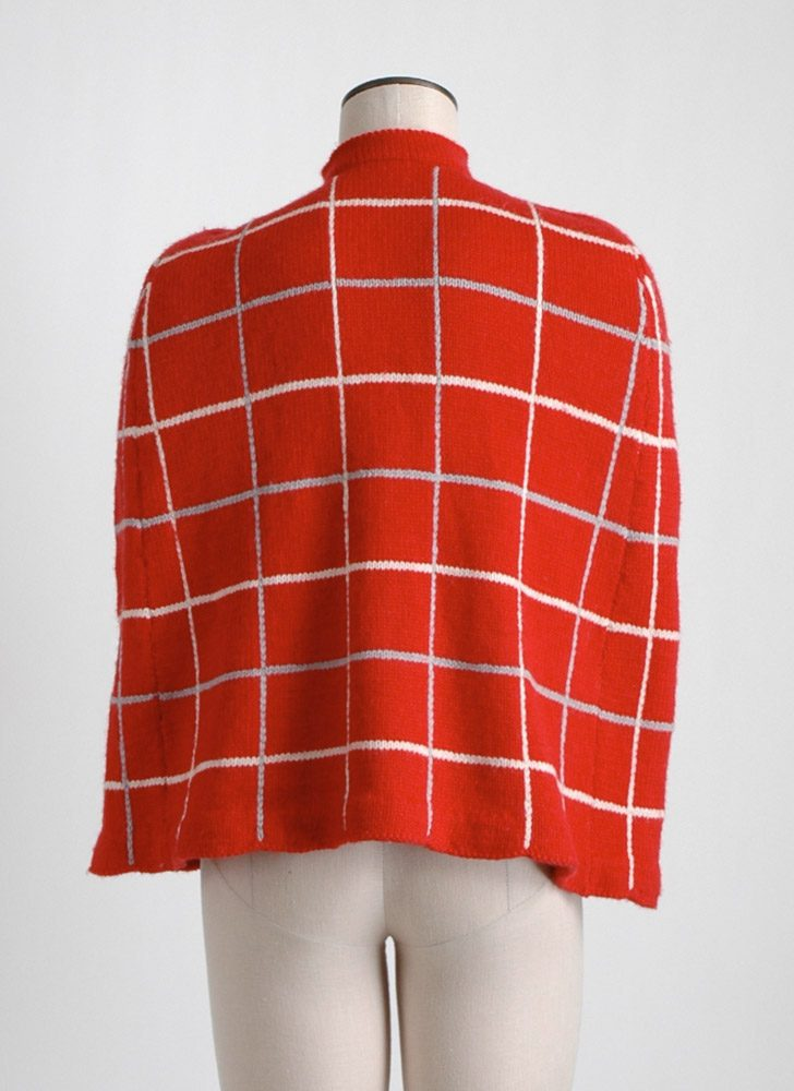 1970s red knit cape with neck clasp